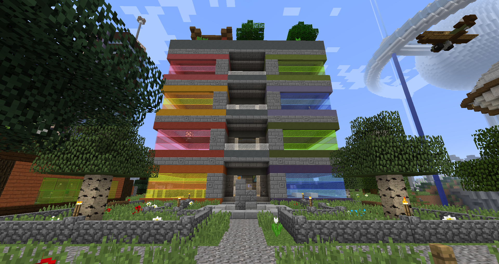 Rainbow-coloured tower of suites in Minecraft